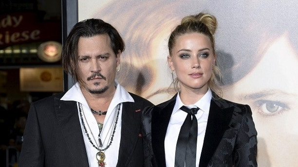"Cast member Amber Heard and husband Johnny Depp pose during the premiere of the film ""The Danish Girl,"" in Los Angeles, California November 21, 2015. REUTERS/Kevork Djansezian/File Photo - TM3EC8G11SK01"