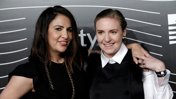 Lena Dunham (R) and Jenni Konner, founders of Lenny Letter, pose as they arrive for the 20th Annual Webby Awards in Manhattan, New York, U.S., May 16, 2016. REUTERS/Mike Segar - S1BETEMANOAA