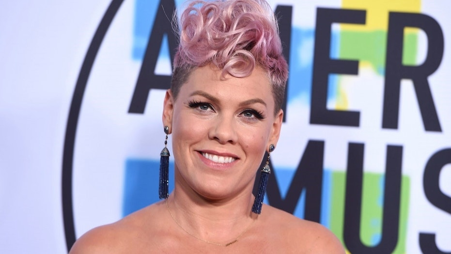 Pink arrives at the American Music Awards at the Microsoft Theater on Sunday.