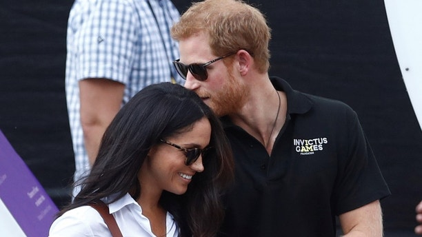 Britain's Prince Harry (R) arrives with girlfriend Meghan Markle at the wheelchair tennis event during the Invictus Games in Toronto, Ontario, Canada September 25, 2017. Picture taken September 25, 2017. REUTERS/Mark Blinch - RC1BC7A98520