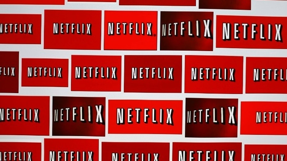 The Netflix logo is shown in this illustration photograph in Encinitas, California October 14, 2014. Netflix Inc <NFLX.O> shares were down 3.1 percent at $435.28 after the announcement. The streaming video company will announced its quarterly results later on October 15. Picture taken October 14, 2014. REUTERS/Mike Blake (UNITED STATES - Tags: ENTERTAINMENT MEDIA BUSINESS LOGO) - TM3EAAF0YT101