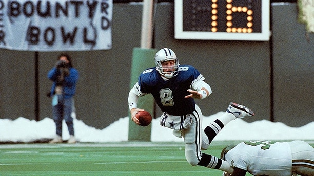 Dallas Cowboys' quarterback Troy Aikman is unable to get a pass off as he is tackled by Eagles' Reggie White during the first half of NFL game on Dec. 10, 1989 in Philadelphia. Eagles won, 20-10. (AP Photo/Brad Bower)