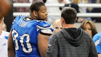 FILE - In this file photo taken Nov. 24, 201, Detroit Lions head coach Jim Schwartz talks with defensive tackle Ndamukong Suh (90) as he leaves the field after being disqualified in the third quarter during an NFL football game against the Green Bay Packers at Ford Field in Detroit. The Packers won 27-15. Suh was ejected from the game after he stepped on a Packers offensive lineman. (AP Photo/The Detroit News, Robin Buckson, File)
