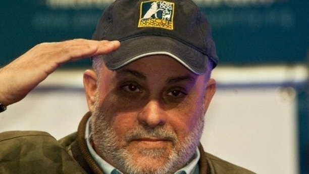 "Conservative radio host Mark Levin acknowledges the crowd after speaking at a ""Cut Spending Now"" rally at the conservative Americans for Prosperity ""Defending the American Dream Summit"" in Washington on Nov. 5, 2011. (NICHOLAS KAMM/AFP/Getty Images)"