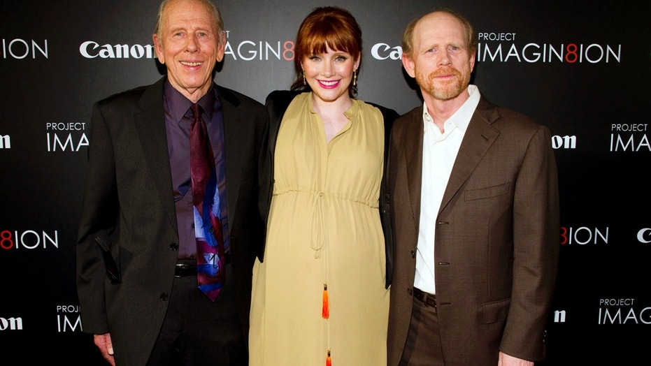 Rance Howard, pictured at left in 2011, was the father of director Ron Howard, right, and the grandfather of actress Bryce Dallas Howard, center.