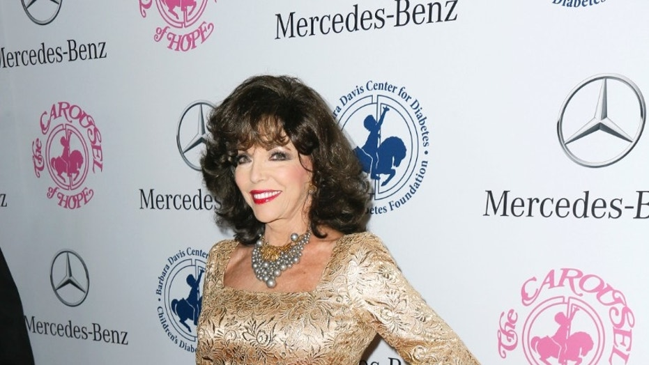 Joan Collins' son has accused her late ex-husband Anthony Newley of being a pedophile. Collins denies the claim. Here, she poses in 2014 on the red carpet in Beverly Hills.
