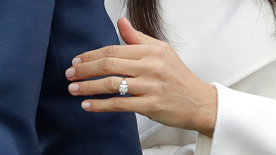 Meghan Markle shows off her engagement ring from Prince Harry on Nov. 27, 2017.
