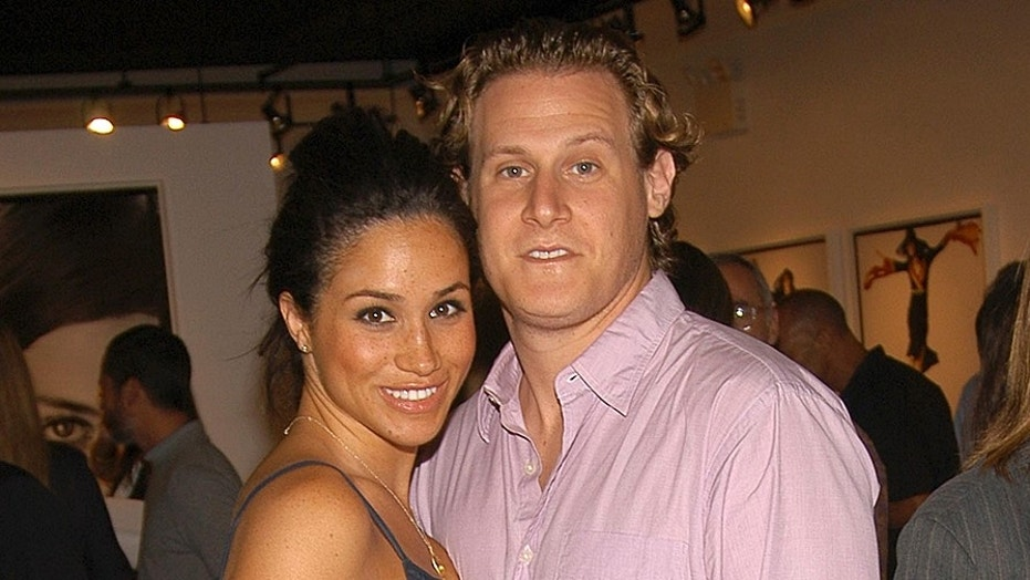 EAST HAMPTON NY- AUGUST 26 Meghan Markle and Trevor Engelson attend COACH Legacy