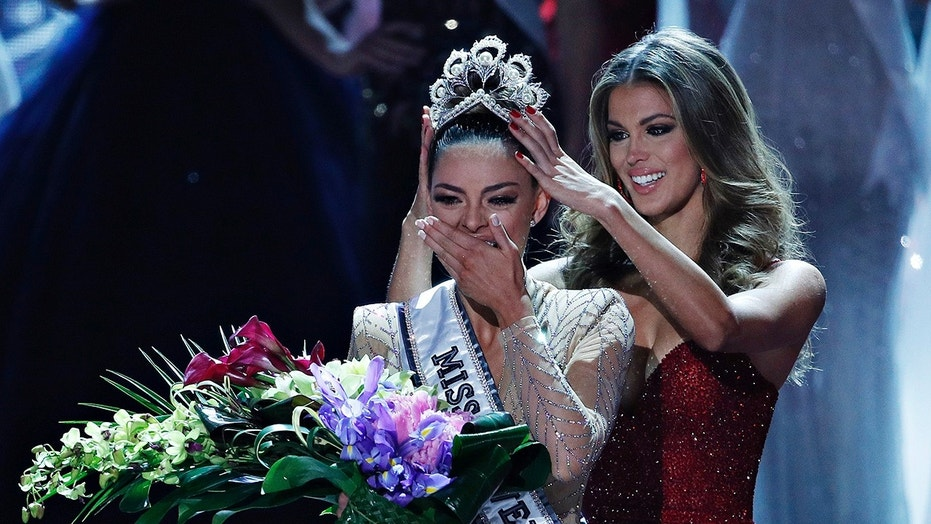 Nov. 26, 2017: Former Miss Universe Iris Mittenaere, right, crowns new Miss Universe Demi-Leigh Nel-Peters at the Miss Universe pageant in Las Vegas.