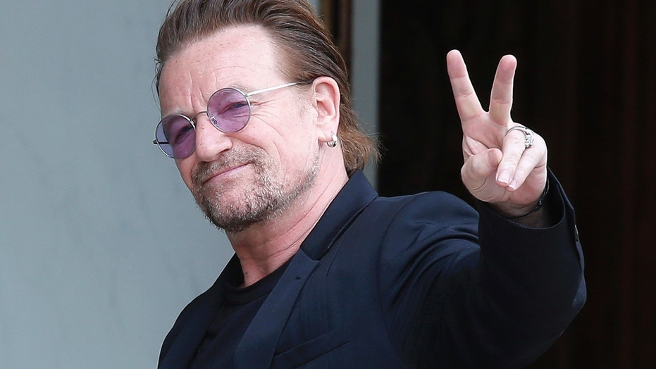In this July 24, 2017, file photo, U2 singer Bono makes a peace sign as he arrives for a meeting at the Elysee Palace, in Paris, France.