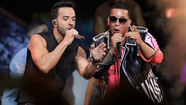 "In this April 27, 2017, file photo, singers Luis Fonsi, left, and Daddy Yankee perform during the Latin Billboard Awards in Coral Gables, Fla. Despacito,"" Fonsi's mega-hit with Daddy Yankee, is nominated for several Grammy Awards including record of the year, song of the year and best pop duo/group performance."