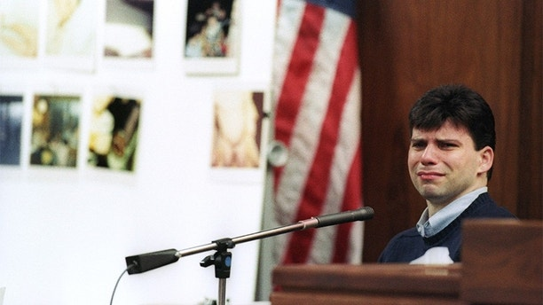 Lyle Menendez, one of two brothers on trial for the shotgun murder of their wealthy parents, breaks down in tears September 10, 1993 as he recalls incidents of sexual abuse by his father during court testimony.  At left are photographs, some showing the genitals of Lyle and brother Erik as children, which the defense claims their father took.  Reuters/Lee Celano - GF2DUMNWFEAC