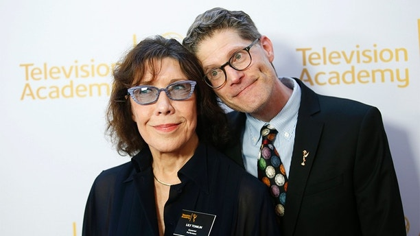 Television Academy Governors Lily Tomlin (L) and Bob Bergen pose together at the Television Academy's Performers Peer Group cocktail reception to celebrate the 66th Primetime Emmy Awards in Beverly Hills, California July 28, 2014. REUTERS/Danny Moloshok (UNITED STATES - Tags: ENTERTAINMENT) - GM1EA7T10MS01