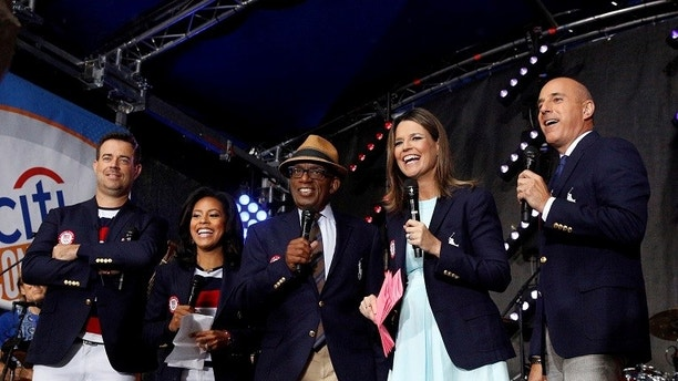 NBC's 'Today' show anchors from-left; Carson Daly, Sheinelle Jones, Al Roker, Savannah Guthrie and Matt Lauer model the official Opening Ceremony outfit that Team USA members will wear by Polo Ralph Lauren in New York City, U.S., July 29, 2016.  REUTERS/Brendan McDermid - S1BETSKBFNAB