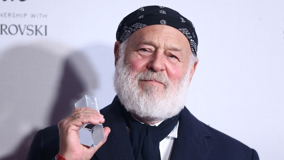 Bruce Weber, who appears above at the Fashion Awards 2016 in London, has been sued by a male model .