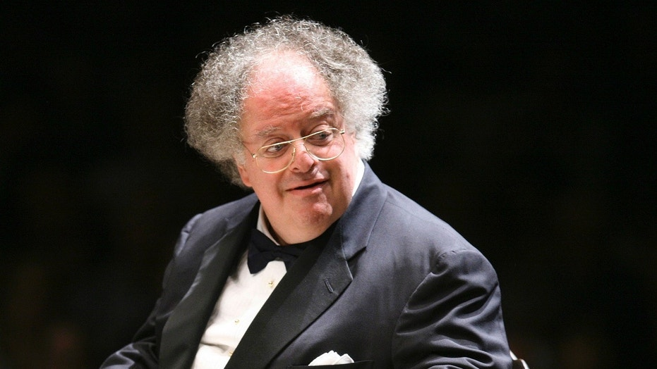 Music director James Levine conducts the Boston Symphony Orchestra on its opening night at Tanglewood in Lenox. Mass
