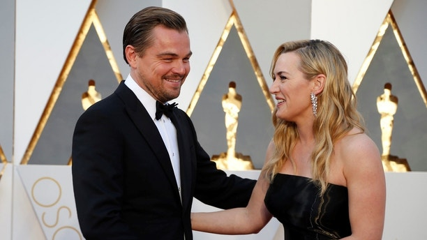 "Kate Winslet, nominated for Best Supporting Actress for her role in ""Steve Jobs,"" and Leonardo DiCaprio, nominated for Best Actor for his role in ""The Revenant,"" arrive at the 88th Academy Awards in Hollywood, California February 28, 2016.    REUTERS/Lucy Nicholson - TB3EC2T02SUXU"