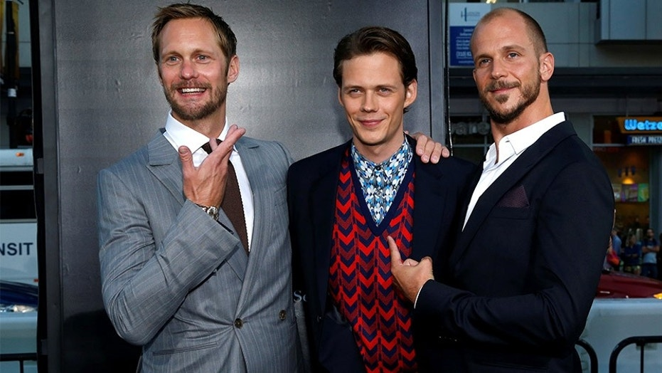 Cast member Bill Skarsgard (C) poses with his brothers Alexander Skarsgard  (L)
