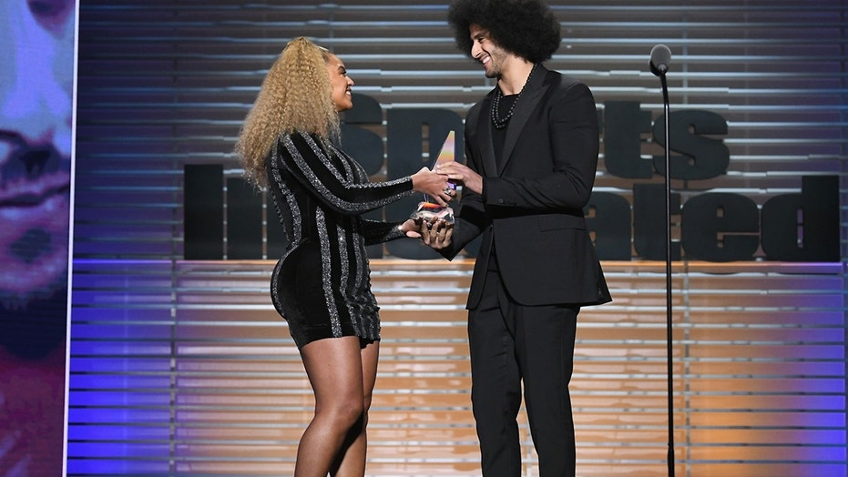 Beyonce presents Colin Kaepernick with the SI Muhammad Ali Legacy Award during SPORTS ILLUSTRATED 2017 Sportsperson of the Year Show on December 5, 2017 at Barclays Center in New York City.