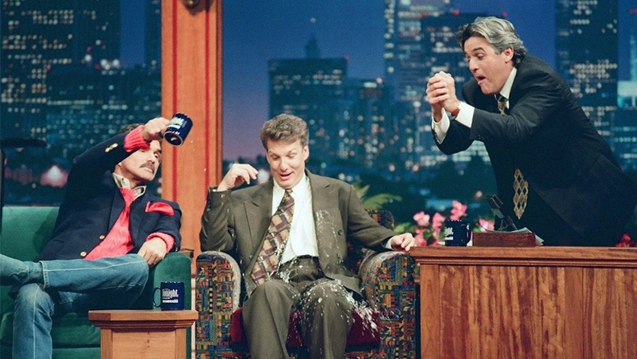 Pictured: (l-r) Actor Burt Reynolds, Television Personality Marc Summers during an interview with host Jay Leno on October 17, 1994.