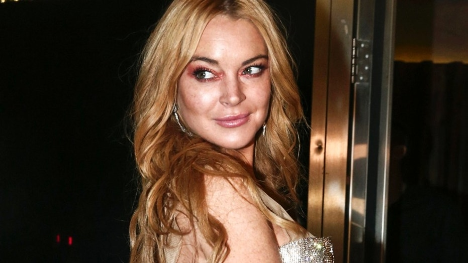 "Lindsay Lohan says she is ready for a ""Mean Girls 2"" movie if the entire cast is ready too. Here Lohan poses for photos at Lohan Nightclub in Athens, Greece."