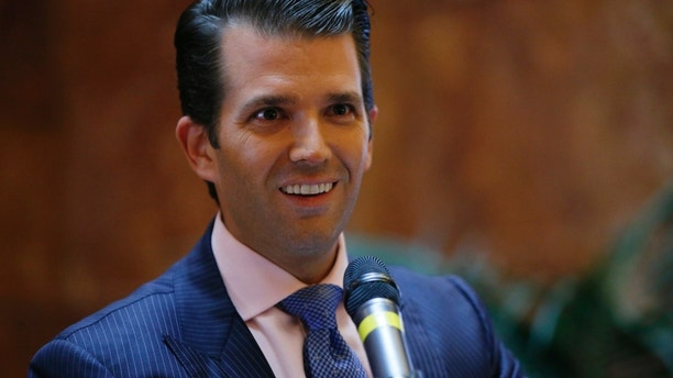"FILE - In this June 5, 2017, file photo, Donald Trump Jr., executive vice president of The Trump Organization, announces that the family's company is launching a new hotel chain inspired by his and brother Eric's Trump's travels with their father's campaign at Trump Tower in New York. Trump Jr. shared a video on July 8, 2017, of an edited clip of the 1986 military thriller ""Top Gun"" in which President Donald Trump's face is superimposed over Tom Cruise's character as he shoots down a Russian jet with a CNN logo on it. (AP Photo/Kathy Willens, File)"