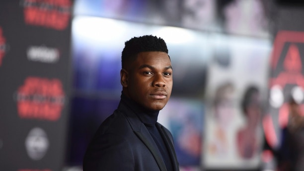 "John Boyega arrives at the Los Angeles premiere of ""Star Wars: The Last Jedi"" at the Shrine Auditorium on Saturday, Dec. 9, 2017 in Los Angeles. (Photo by Jordan Strauss/Invision/AP)"