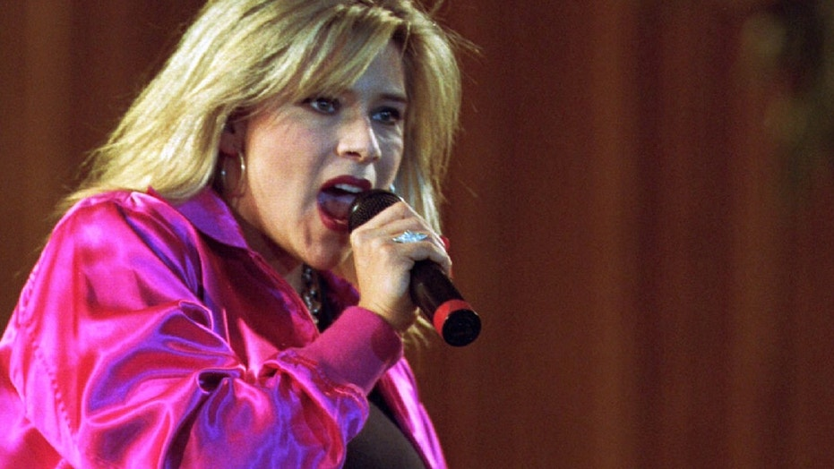 British singer Samantha Fox performing at Miss-Romania contest in Bucharest May 20, 1995.