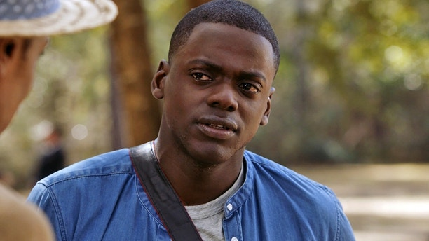 "This image released by Universal Pictures shows Daniel Kaluuya in a scene from, ""Get Out."" On Monday, Dec. 11, 2017, he was nominated for a Golden Globe for best actor in a motion picture comedy or musical for his role in the film. The 75th Golden Globe Awards will be held on Sunday, Jan. 7, 2018 on NBC.  (Universal Pictures via AP)"