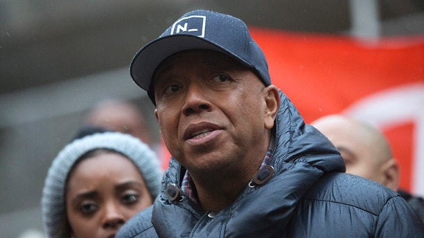 Rap mogul Russell Simmons speaks at a news conference along with members of Justice League NYC to present a list of demands at City Hall in New York December 10, 2014. The league, made up of of juvenile and criminal justice advocates, artists and experts, and formerly incarcerated individuals, presented the list in response to the failure of a Staten Island Grand Jury to indict police officer Daniel Pantaleo for the chokehold death of Eric Garner. REUTERS/Andrew Kelly (UNITED STATES - Tags: CRIME LAW CIVIL UNREST POLITICS) - GM1EACB0MAH01