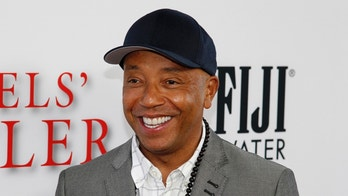 "Russell Simmons arrives as a guest to the premiere of the new film ""Lee Daniels' The Butler"" in Los Angeles, California August 12, 2013. REUTERS/Fred Prouser (UNITED STATES - Tags: ENTERTAINMENT HEADSHOT) - GM1E98D16CE01"