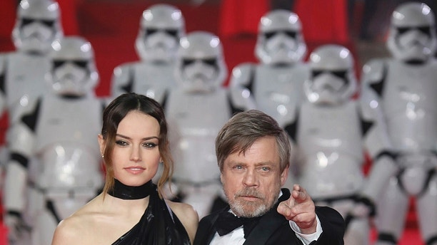 Actors Daisy Ridley, left, and Mark Hamill pose for photographers upon arrival at the premiere of the film 'Star Wars: The Last Jedi' in London, Tuesday, Dec. 12th, 2017. (Photo by Vianney Le Caer/Invision/AP)