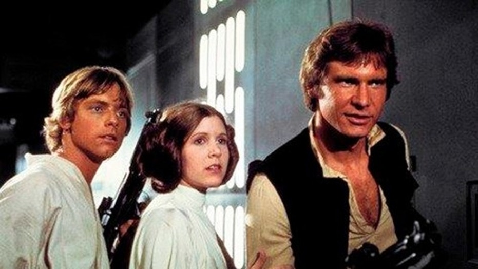 "This photo provided by Twentieth Century Fox Home Entertainment shows, Mark Hamill, from left, as Luke Skywalker, Carrie Fisher as Princess Leia Organa, and Harrison Ford as Hans Solo in the original 1977 ""Star Wars: Episode IV - A New Hope."" The  four-day Star Wars Celebration kicked off Thursday, April 13, 2017 in Orlando, Fla., marking the 40-year anniversary of Lucas' space saga. (Twentieth Century Fox Home Entertainment via AP)"