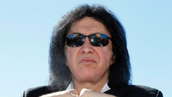 Musician Gene Simmons of rock band KISS attends a news conference to announce his part-ownership of Arena Football League team, the Los Angeles Kiss, in Anaheim, California March 10, 2014. Simmons and bandmate Paul Stanley are part-owners of the LA Kiss, who will play their home games in Anaheim, and the season kick-off will include a concert by KISS. REUTERS/Alex Gallardo (UNITED STATES - Tags: SPORT ENTERTAINMENT) - RTR3GHXP