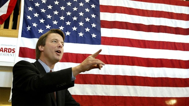Democratic presidential candidate, North Carolina Senator John Edwards speaks in front of a giant U.S. flag as he drums up support at Fairmeadows retirement village in West Des Moines, Iowa January 13, 2004. In the run up to the January 19 Iowa caucus, Edwards focussed on the values of work, savings, learning and responsibility, and his plan to lift 10 million Americans out of poverty. REUTERS/Jason Reed  JIR - RP4DRIFZJMAC