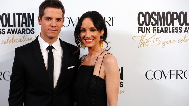 Television personalities Jason Kennedy (L) and Catt Sadler arrive at the Cosmopolitan Fun Fearless Awards in New York March 5, 2012. REUTERS/Allison Joyce (UNITED STATES - Tags: ENTERTAINMENT) - GM1E8360SBT01