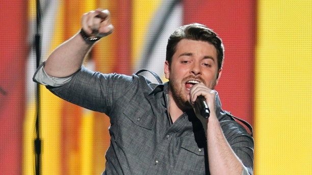 """Singer Chris Young performs """"Save Water, Drink Beer"""" at the 47th annual Academy of Country Music Awards in Las Vegas, Nevada April 1, 2012.  REUTERS/Steve Marcus   (UNITED STATES - Tags: ENTERTAINMENT) (ACM-SHOW) - RTR30849"""