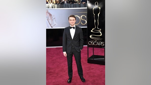 Actor Daniel Radcliffe arrives at the 85th Academy Awards at the Dolby Theatre on Sunday Feb. 24, 2013, in Los Angeles. (Photo by John Shearer/Invision/AP)