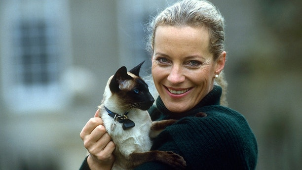 UNITED KINGDOM - NOVEMBER 04:  Princess Michael Of Kent Holding Her Pet Siamese Cat In The Gardens Of Her Home, Nether Lypiatt Manor.  The Princess Is Wearing A Dark Green Wool Cardigan And Matching Scarf.  (Photo by Tim Graham/Getty Images)