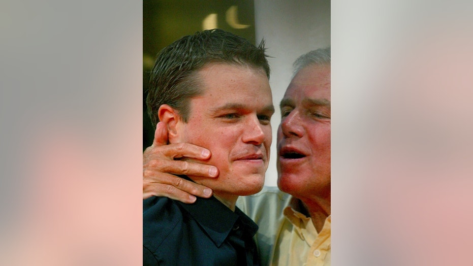 "In this Sept. 5, 2004 file photo, Matt Damon is kissed by his father, Kent , before the screening of the film ""The Bourne Supremacy"" at the 30th American Film Festival of Deauville, Normandy, France."