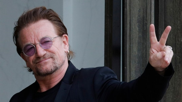 Singer Bono of Irish band U2 and co-founder of ONE organization waves as he arrives at the Elysee Palace in Paris, France, July 24, 2017.     REUTERS/Philippe Wojazer - RC1A49906740