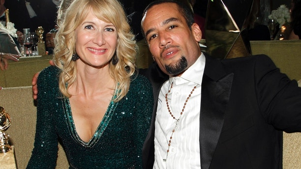"Actress Laura Dern, winner of the award for best performance by an actress in a television series - comedy or musical for ""Enlightened,"" poses with Ben Harper and her award inside the HBO after party after the 69th annual Golden Globe Awards in Beverly Hills, California January 15, 2012."