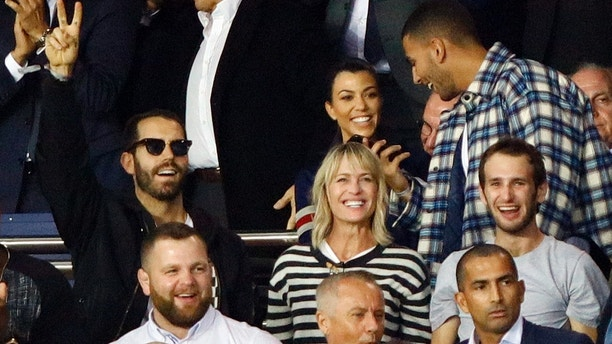 Robin Wright (C) and Kourtney Kardashian and her boyfriend Younes Bendjima during the soccer match game between PSG and Bayern in Paris, France, on September 27, 2017. (Photo by Mehdi Taamallah / Nurphoto)