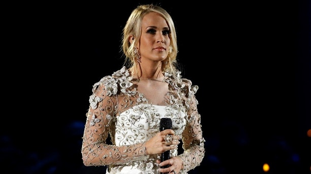 "51st Country Music Association Awards – Show - Nashville, Tennessee, U.S., 08/11/2017 - Carrie Underwood performs ""Softly and Tenderly"" during the in memoriam segment of the show. REUTERS/Mario Anzuoni - HP1EDB9096KOD"