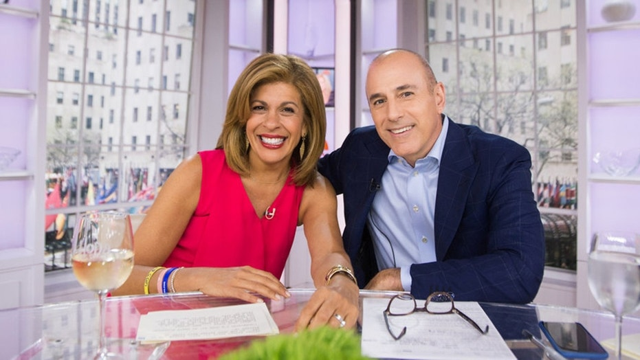 "Matt Lauer (right) congratulated Hoda Kotb after she was named as his replacement on ""Today."""