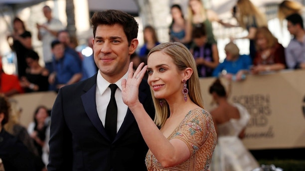 Actors John Krasinski and Emily Blunt arrive at the 23rd Screen Actors Guild Awards in Los Angeles, California, U.S., January 29, 2017.   REUTERS/Mario Anzuoni  - HT1ED1U00QW56