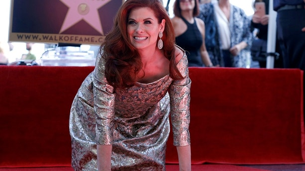 Debra Messing poses on her star after it was unveiled on the Hollywood Walk of Fame in Los Angeles, California, U.S., October 6, 2017.