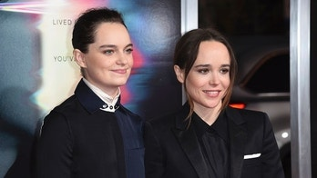 "FILE - In this Sept. 27, 2017 file photo, Emma Portner, left, and Ellen Page arrive at the world premiere of ""Flatliners"" at The Theatre at Ace Hotel  in Los Angeles.  Page has married Portner, her publicist confirms.  Page, 30, first posted the news on Instagram Wednesday, Jan. 3, 2018,  with a photo of the couple's hands wearing wedding bands on their ring fingers.   (Photo by Richard Shotwell/Invision/AP, File)"