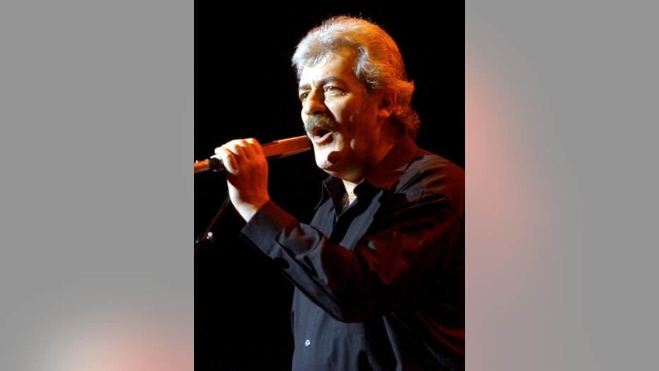 "Singer Ray Thomas of the legendary British rock group ""The Moody Blues"" performs during the first of four shows at Le Theatre des Arts at the Paris Las Vegas hotel-casino in Las Vegas April 5, 2001.