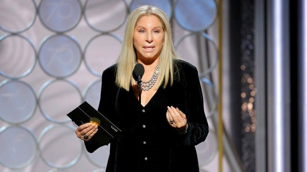 This image released by NBC shows presenter Barbra Streisand at the 75th Annual Golden Globe Awards in Beverly Hills, Calif., on Sunday, Jan. 7, 2018. (Paul Drinkwater/NBC via AP)